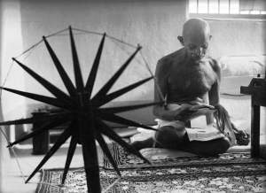 """Caption from LIFE. """"At 76, the Mahatma is in good physical condition. He weighs 110 pounds, but he is not so frail as he looks.""""http://time.com/3639043/gandhi-and-his-spinning-wheel-the-story-behind-an-iconic-photo/"""