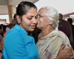 In this August 5, 2014 file photo, one of the 44 Kerala nurses evacuated from Libya is greeted by a relative on her arrival at the airport in Kochi. The nurses said about 100-150 Indian nationals had stayed back in Tripoli waiting for their salaries. As Libya — particularly capital Tripoli and another major city Benghazi — witnessed the fiercest violence since the fall of Muammar Qadhafi three years ago, several countries have evacuated their diplomats and nationals from the African country's strife-torn areas. http://www.thehindu.com/news/national/kerala-nurses-back-from-libya-thank-government/article6299247.ece